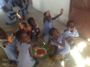 Children in village school enjoy their breakfast