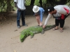 Stroking Charlie the croc at the crocodile pool
